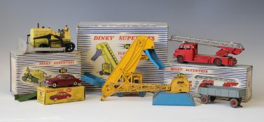 A small collection of Dinky Supertoys vehicles and accessories, comprising a No. 956 turntable
