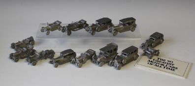 A set of Danbury Mint pewter models of 'The Greatest Motor Cars of All Time' (some faults), with