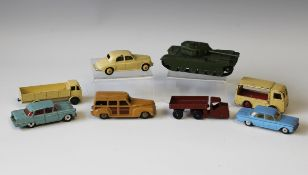 Seven Dinky Toys vehicles, including a No. 651 Centurion tank, a No.33w mechanical horse and trailer