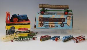 A Britains No. 9525 Fordson Super Major tractor and a No. 9560 timber trailer, both boxed with inner