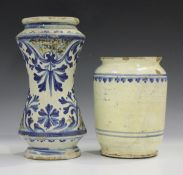 An Italian maiolica albarello, Sicily, early 18th century, of waisted form, painted in blue with a
