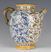 An Italian maiolica wet drug jar, probably Deruta, 17th century, the ovoid body painted to the front
