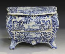 A Dutch Delft miniature model of a commode, 19th century, of bombé form with two workable drawers,
