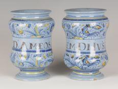A pair of Italian maiolica small berettino albarelli or pill jars, Faenza, mid-18th century, both of