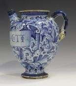 An Italian maiolica syrup or wet drug jar, probably Venetian, late 16th century, painted in dark