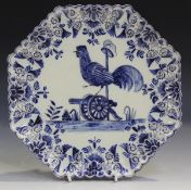 A French faience commemorative plate, 19th century, of octagonal shape, painted in blue with a