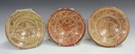 Three small Hispano-Moresque lustre pottery dishes, probably 18th century, two painted with a