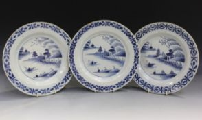 Three English Delft plates, mid-18th century, each painted in blue with a chinoiserie landscape