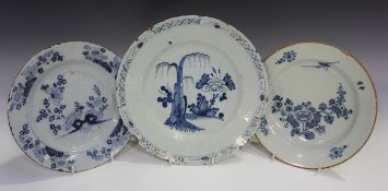 An English Delft plate, probably London, mid-18th century, painted in blue chinoiserie style with