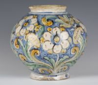 A Sicilian maiolica jar, 17th century, the bulbous body painted with white flowers and foliage in