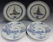 A pair of English Delft plates, probably Lambeth, circa 1760, polychrome painted in blue, manganese,