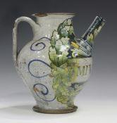 An Italian maiolica wet drug jar, of Castel Durante type with Gubbio style lustre decoration,
