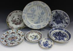 An unusual Delft charger, mid to late 18th century, painted in blue with two chinoiserie figures
