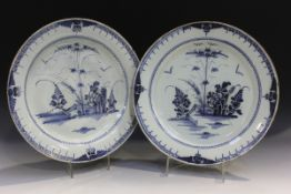 A large pair of English Delft chargers, Lambeth, circa 1780, painted in blue with a chinoiserie