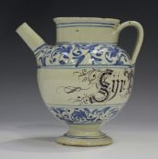 An Italian maiolica syrup jar, Savona, 18th century, the rounded body inscribed in cursive manganese