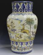 A large Spanish faience floor vase, late 19th/early 20th century, polychrome painted with a
