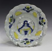 An unusual Delft portrait dish, late 17th/early 18th century, of circular shape, moulded with two