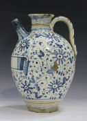 An Italian maiolica wet drug jar, probably Montelupo, late 17th or 18th century, the ovoid body