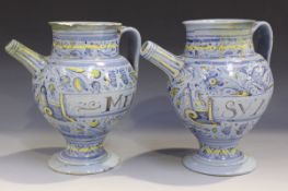 A pair of Italian maiolica small berettino syrup or wet drug jars, mid-17th century, the bulbous