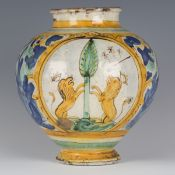 A Sicilian maiolica bombola, Caltagirone, 18th century, the rounded body painted with a pair of