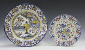 A Dutch Delft charger, mid-18th century, polychrome painted in chinoiserie style with a central