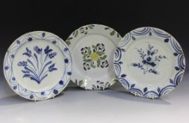 A naïve English Delft plate, probably London or Bristol, mid-18th century, of 'pancake' form,