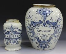 A Dutch Delft pharmacy jar, 18th century, of albarello form, painted in blue with a label