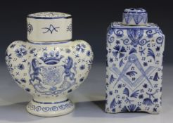 An unusual Dutch Delft tea caddy and cover, 19th century, of shouldered rectangular form, painted to