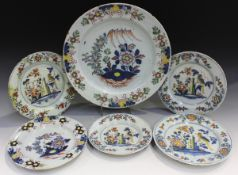 An English Delft charger, London, circa 1750-60, painted in blue, green, red, yellow and manganese
