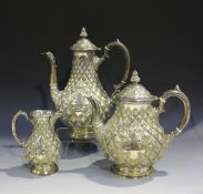 A Victorian plated three-piece tea set of pineapple moulded baluster form, comprising teapot, hot