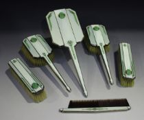 A George V silver, two-colour green and jade set six-piece dressing table set, each decorated in a