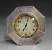 A George V silver octagonal cased bedside timepiece, the dial with Arabic numerals and detailed '8-