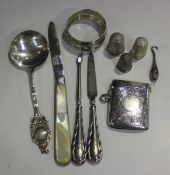 A group of silver items, comprising an Edwardian rectangular vesta case with engraved decoration,