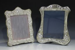 An Elizabeth II silver mounted photograph frame of shaped rectangular form, embossed with flowers