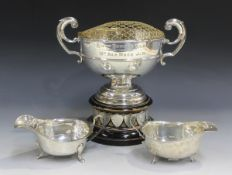An Edwardian silver two-handled trophy cup with flying scroll handles, Sheffield 1909, height 15.5cm