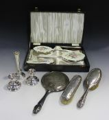 A plated and enamelled four-piece dressing table set, comprising hand mirror, comb, hairbrush and