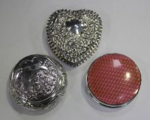 A late Victorian silver heart shaped box, the hinged lid embossed with scrolls, Birmingham 1900 by