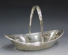 A late Victorian silver oval boat-shaped bread basket with swing handle, the pierced body with