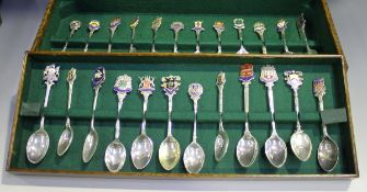 A group of forty-one Elizabeth II silver souvenir spoons, the majority with enamelled terminals,