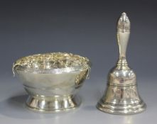An Elizabeth II silver bell with turned handle, Birmingham 1969, height 11.1cm, together with a