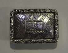 A William IV silver rectangular vinaigrette, the hinged lid engraved with geometric decoration