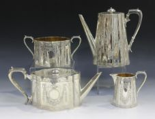 A Victorian silver harlequin four-piece tea set, each piece of shaped oval form, engraved with