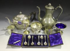 A collection of plated items, including a pair of candlesticks, two teapots and a tankard.Buyer's