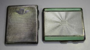 A George V silver and enamelled engine turned rectangular cigarette case, the front with white and