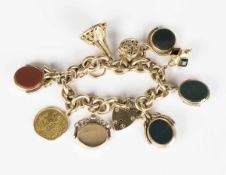 A 9ct gold oval link charm bracelet, fitted with ten pendants and charms, including four agate set