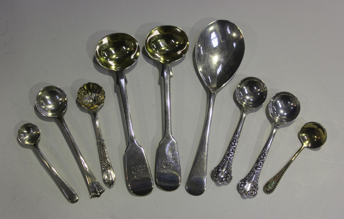 A small group of silver flatware, comprising a pair of Victorian fiddle pattern salt spoons,