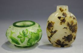 A Chinese agate snuff bottle, probably late Qing, of flattened ovoid form, carved in low relief with