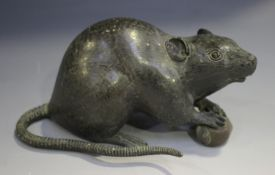 A Japanese brown patinated bronze figure of a rat, Meiji period, modelled clasping a nut,