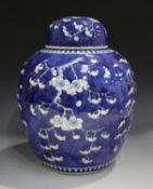 A Chinese blue and white porcelain ginger jar and cover, mark of Kangxi but late 19th century,