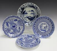 A Chinese blue and white porcelain circular dish, Kangxi period, the central panel painted with